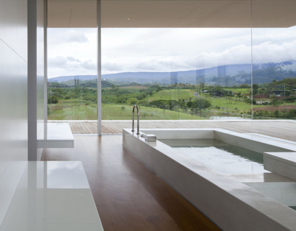 Natural-and-Elegant-Indoor-Swimming-Pool-House-Design-with-Mountain-View-with-Windows-Wall-for-Outdoor-View-and-White-Interior-Coloring-and-Wood-Flooring